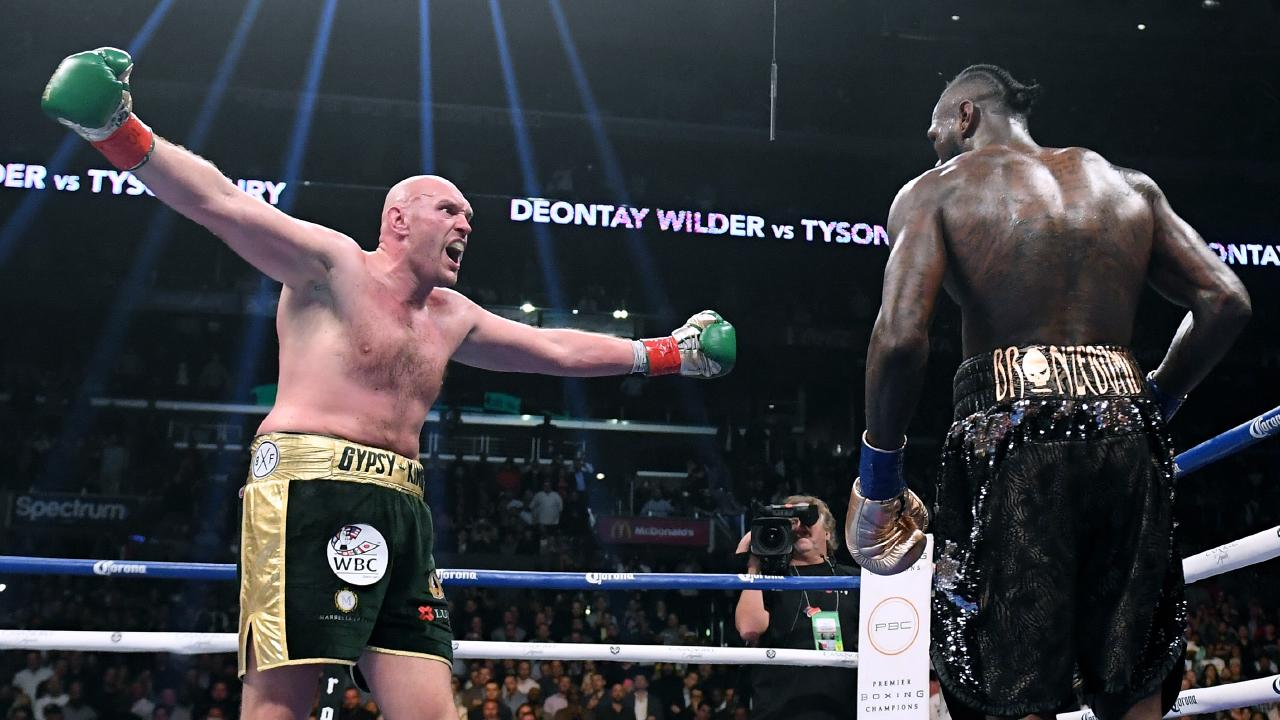 LOS ANGELES, CA - DECEMBER 01: Tyson Fury taunts Deontay Wilder in the ninth round fighting to a draw during the WBC Heavyweight Champioinship at Staples Center on December 1, 2018 in Los Angeles, California. (Photo by Harry How/Getty Images)