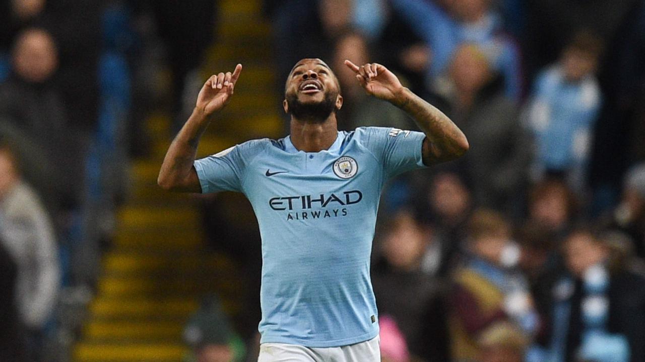 Manchester City's English midfielder Raheem Sterling celebrates scoring their second goal
