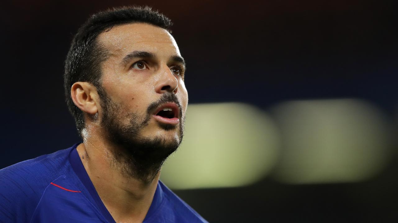 Pedro of Chelsea looks on.
