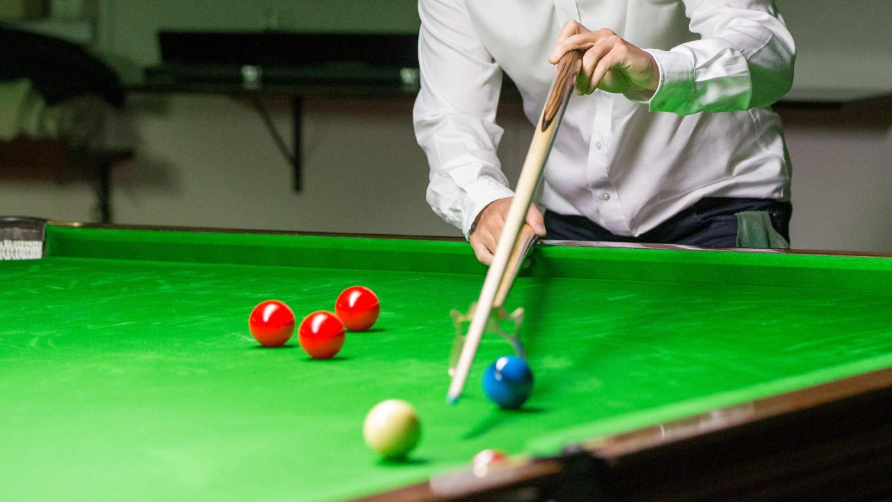A snooker player has been banned for 10 years for match-fixing.