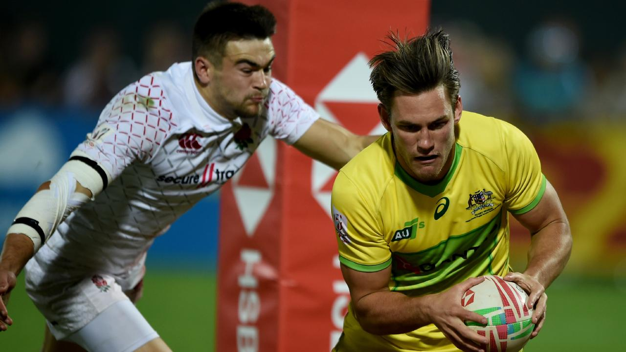 Lachie Anderson of Australia scores a try during the bronze playoff in Dubai.