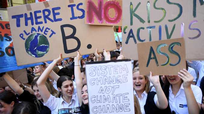 Students' abuisive signs say it all. Picture: AAP/Dan Himbrechts