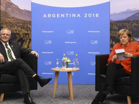 German Chancellor Angela Merkel checks her notes as she sits down for a bilateral meeting with Australian PM Scott Morrison at the G20 summit in Buenos Aires. Picture: AAP