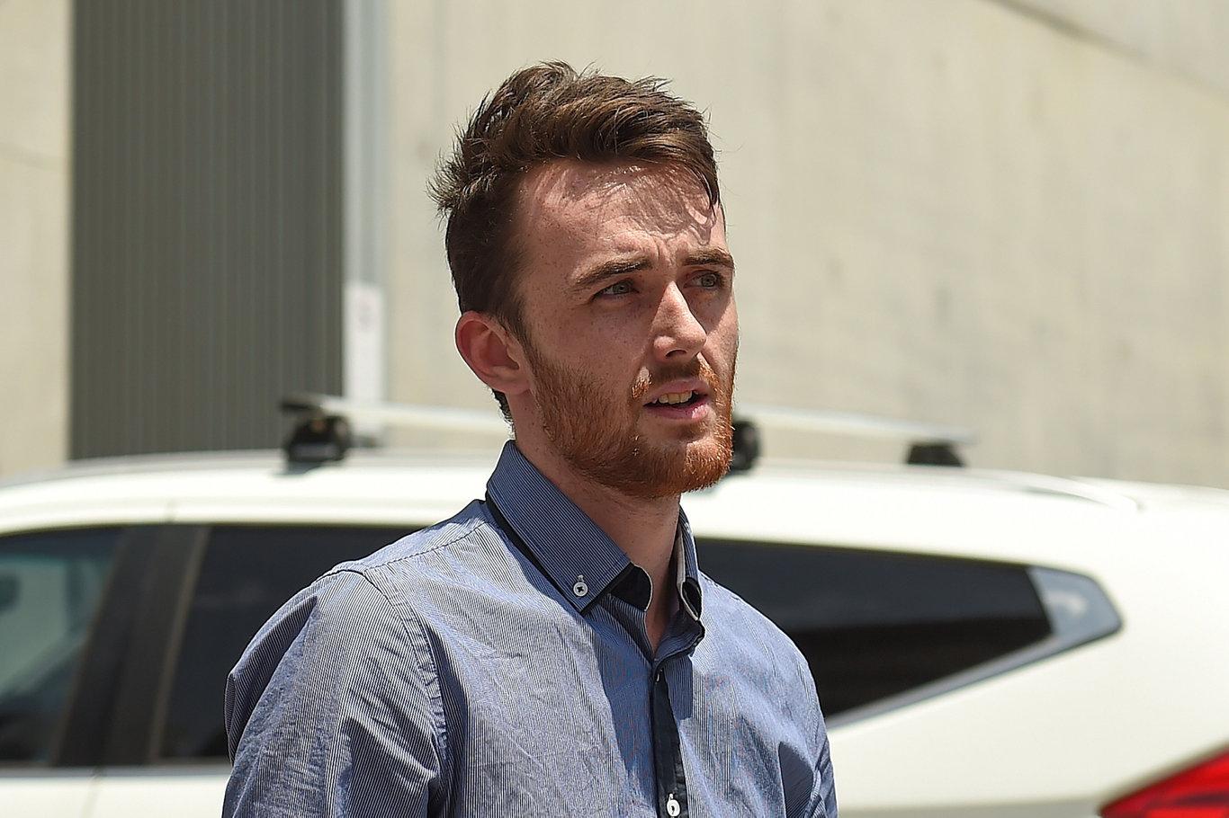 Jack Reynolds, son of Michelle Reynolds, outside Brisbane Supreme Court.