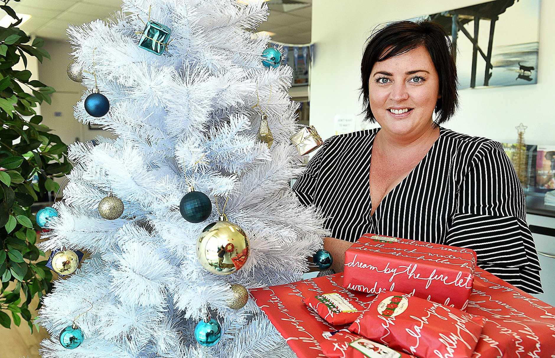 Hervey Bay Independent journalist Jodie Callcott is calling for presents to be left under the Indy and Chronicle Giving Tree at the Hervey Bay office.