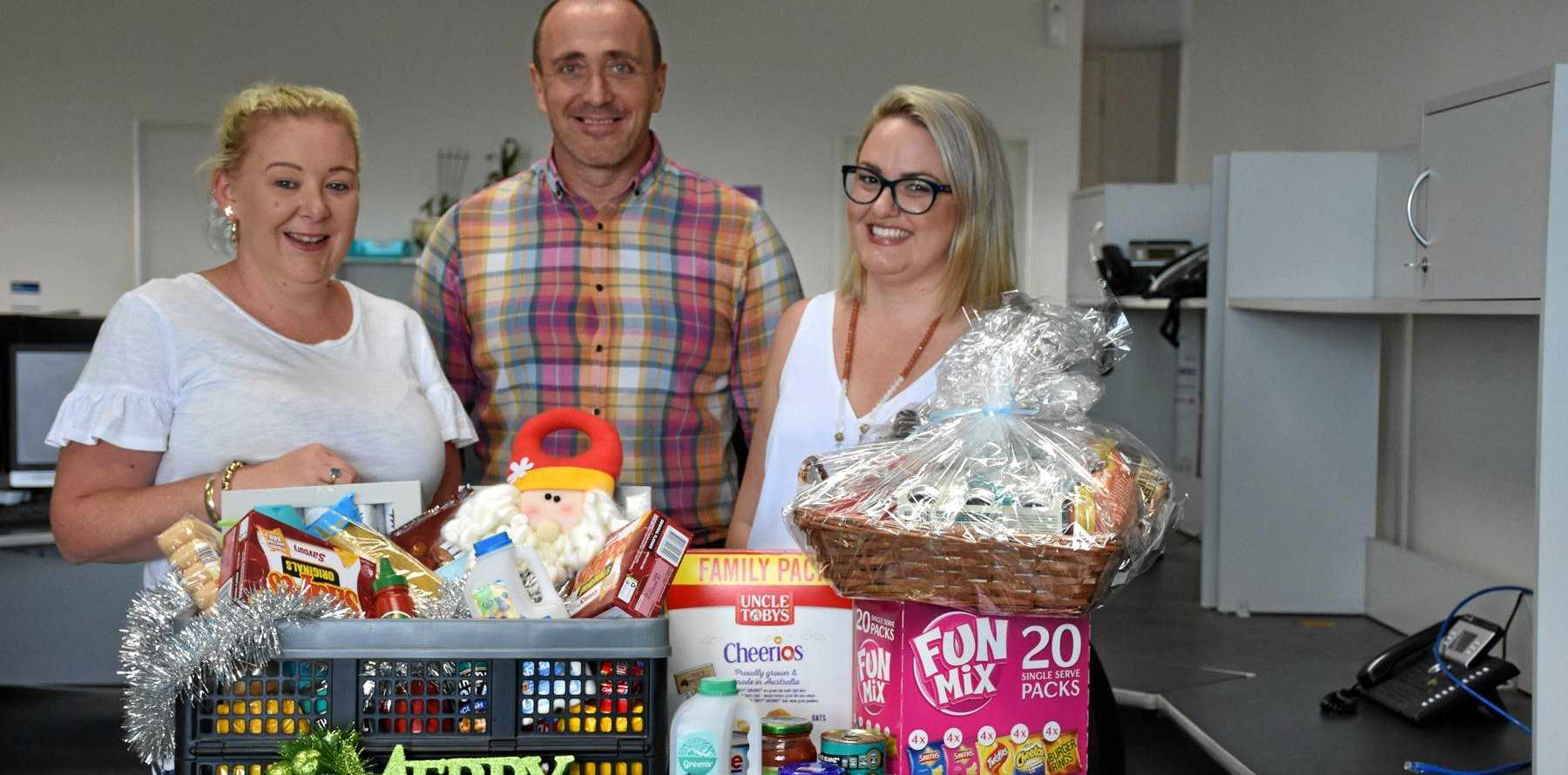 THANK YOU: West Moreton Health's Clinical Governance team members Kirsty McCoombes, Mark O'Connell and Vicky Bates are collecting donations to support two families for the Adopt-a-Family campaign.