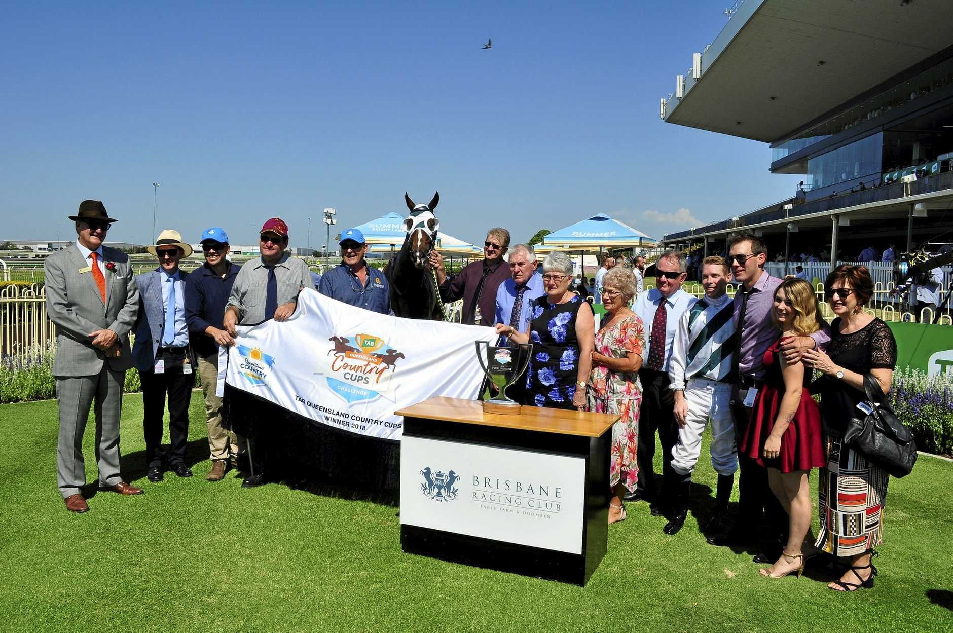 Brenton Andrew-trained Baker Boy and winning connections at Doomben on Saturday.