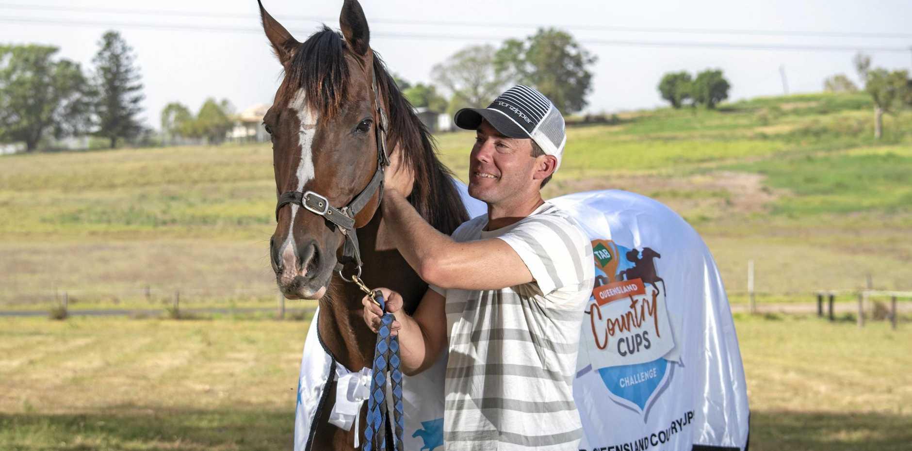 Brenton Andrew with racehorse Baker Boy.