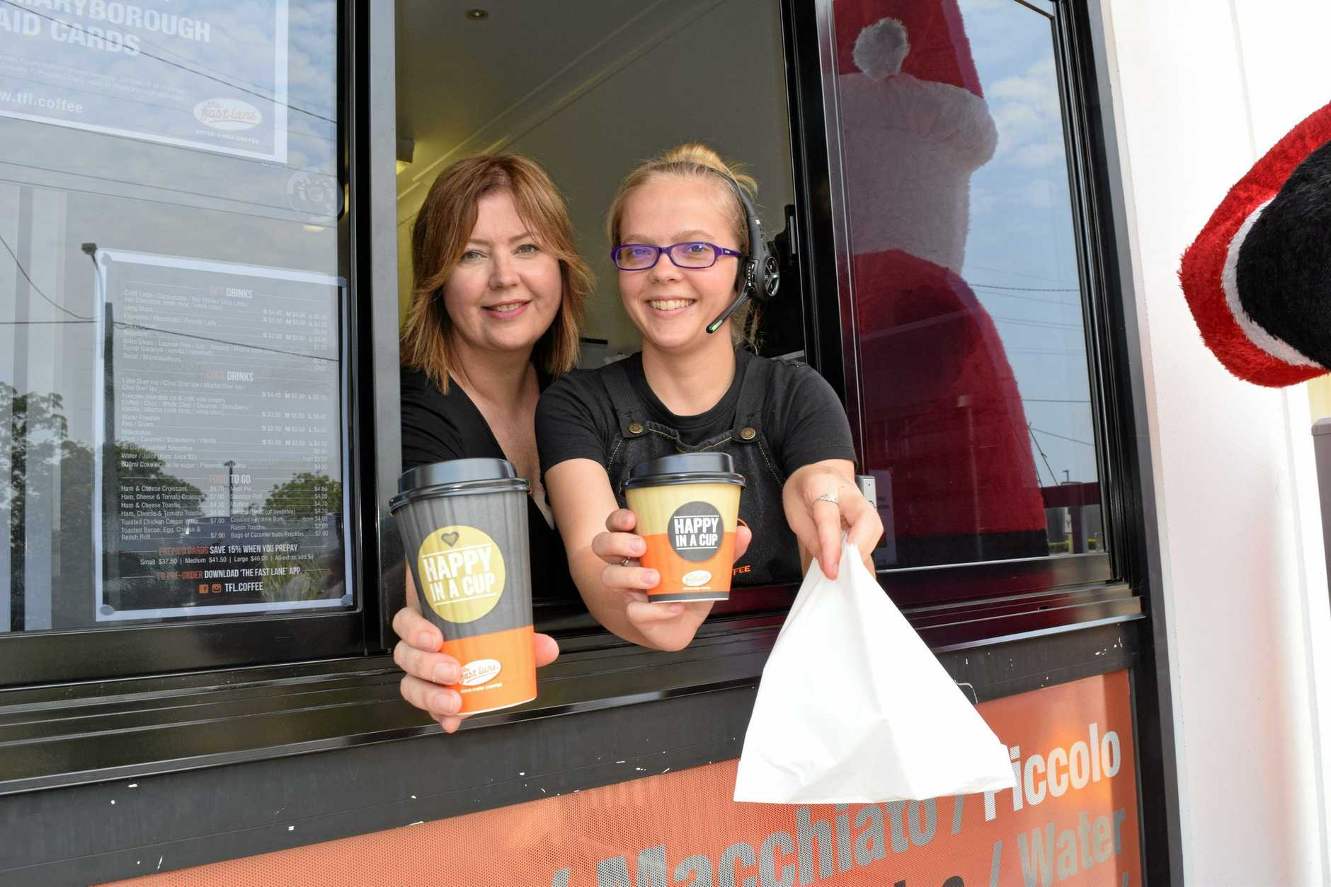 DRIVE THRU TWIST: The Fast Lane Drive Thru Coffee's Amy Bates, 25, and franchisor Paula Anderson at the new Maryborough Drive Thru. The store opened on Monday and serves coffee, hot and cold drinks and food to those on the road.