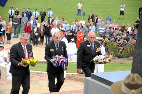Late Gympie mayor Ron Dyne, Leading Seaman Alan D Birkenhead, Ivan Friske pay their respects at Normanby Hill.