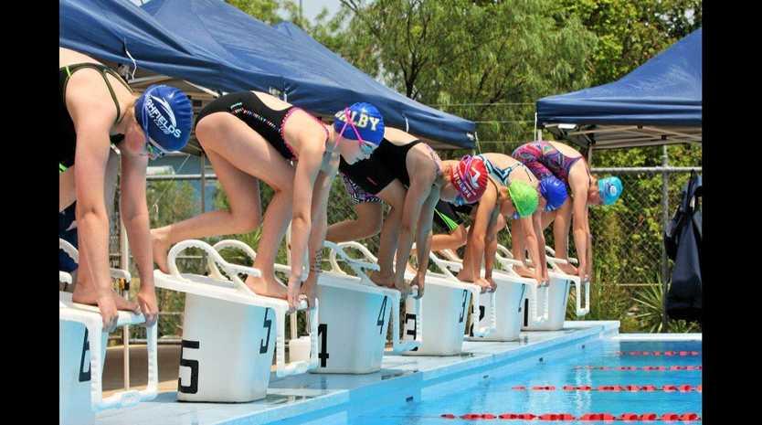 SPLASH: Ella McGlashan (far right) prepares to dive at the Dalby Open on Sunday.