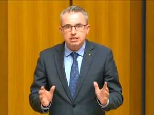 Hogan brings royal commission into parliament