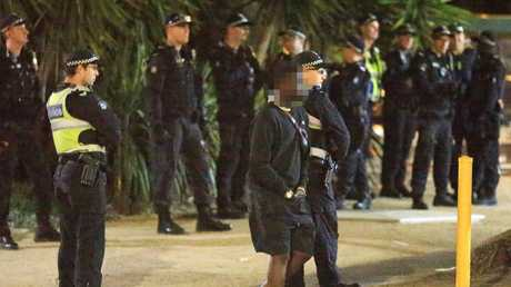Police watched as youths gathered outside St Kilda McDonald's. Picture: Mark Stewart