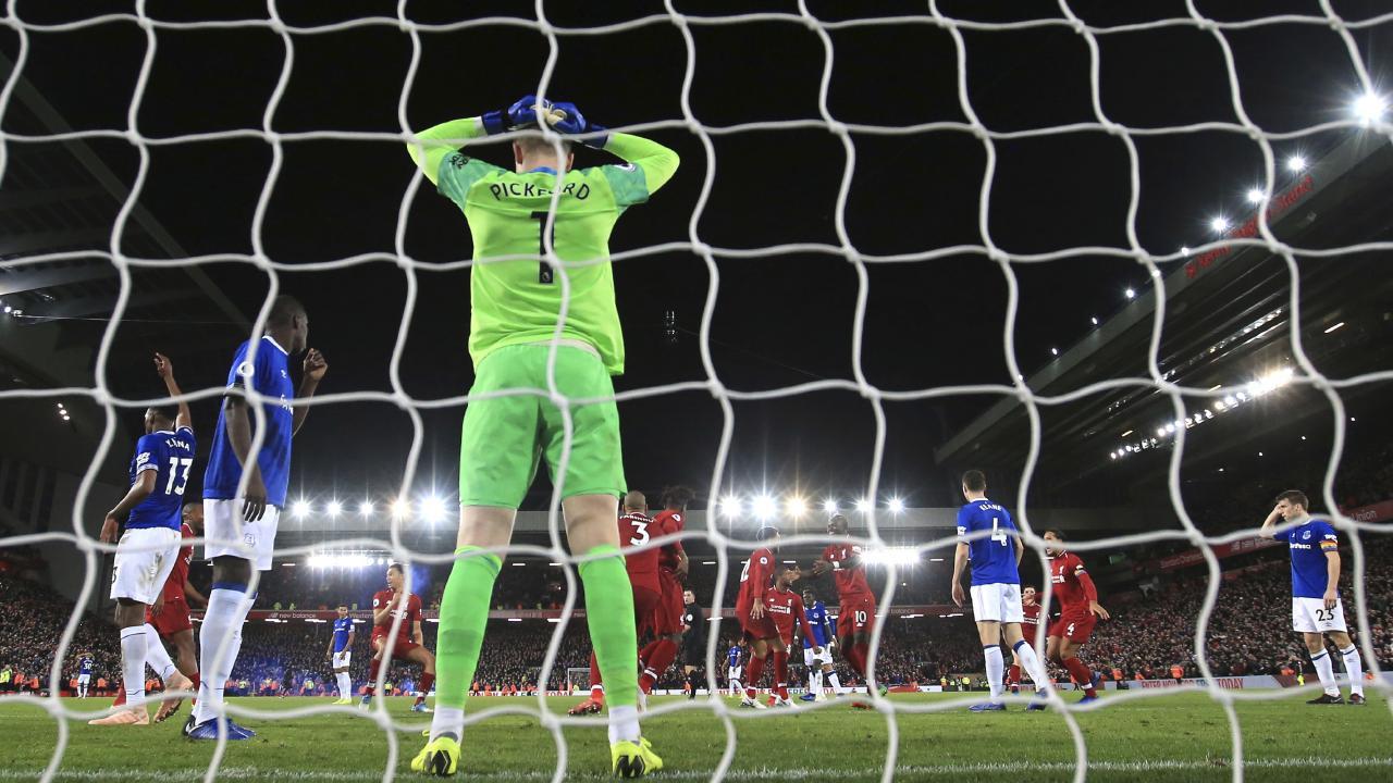 Everton goalkeeper Jordan Pickford reacts after Liverpool forward Divock Origi scored his side's first goal