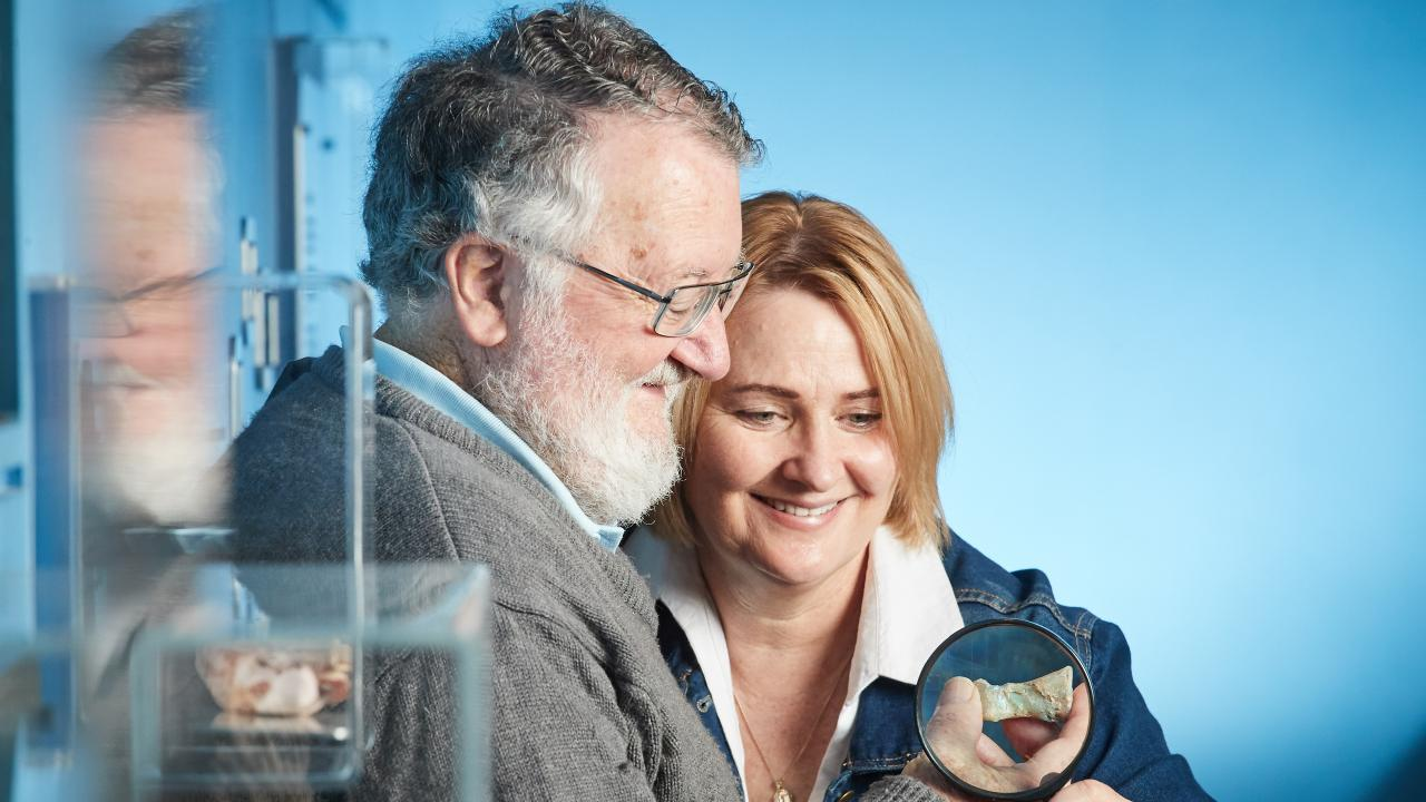 Honorary researcher Neville Pledge and Joy Joyleen with the opalised toe bone. Picture: Matt Loxton