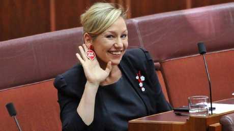 Queensland Greens Senator Larissa Waters wears Stop Adani earrings in Senate.