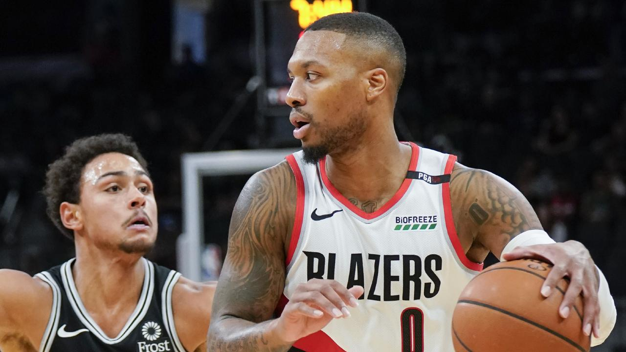 Portland's Damian Lillard did his bit for the punter in the game against San Antonio. (AP Photo/Darren Abate)
