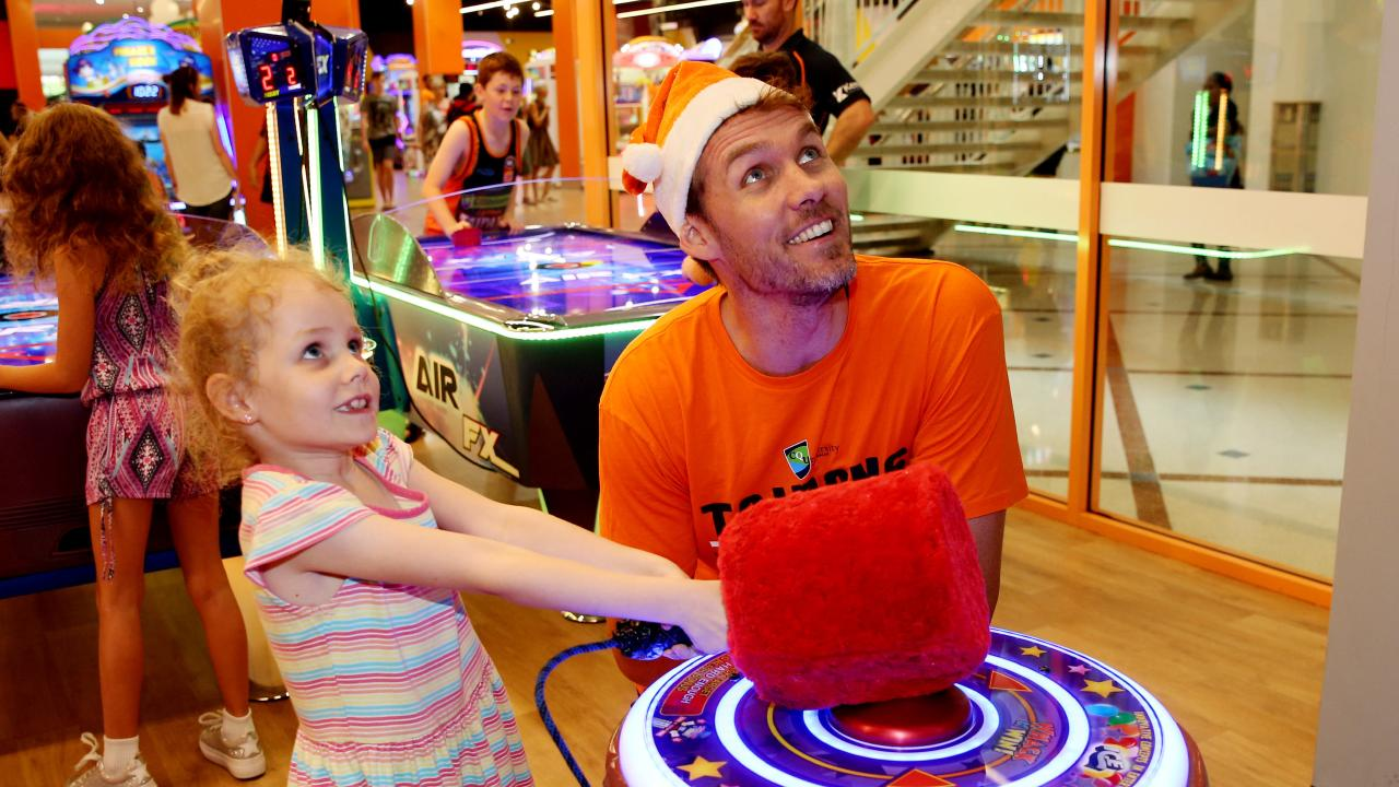 GOOD BREAK: Alex Loughton with his daughter Ivy, 6, at the Taipans Members Christmas Party at iPlay, Cairns Central Shopping Centre. Picture: STEWART McLEAN