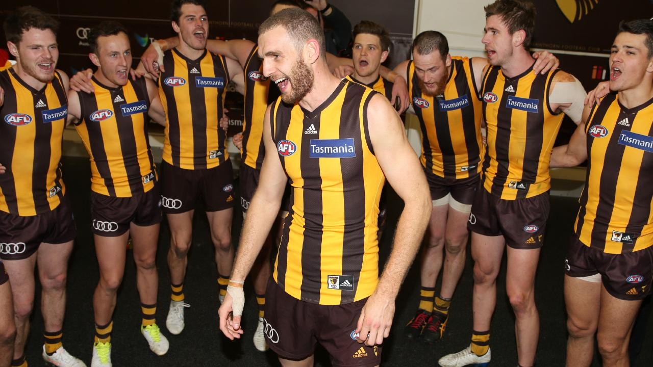 Kurt Heatherley sings the song after playing in his first win for Hawthorn. Picture: Michael Klein