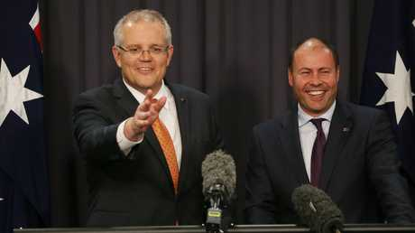 Mr Morrison and Mr Frydenberg have a laugh with the media during the press conference in Parliament House in Canberra. Picture: Gary Ramage