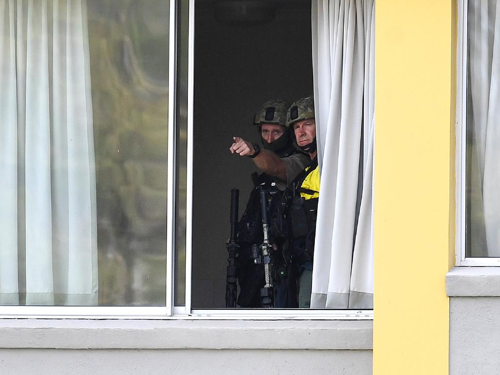 Police Special Emergency Response Team (SERT) officers were inside the Chasely Apartment Hotel, above the two men. Picture: AAP/Dan Peled
