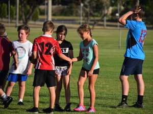 GOOD SPORTS: Players shake hands after the Under 10