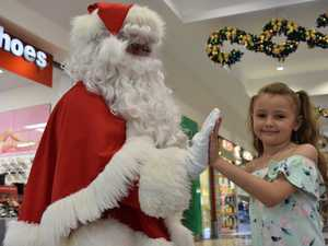 HO HO HO: Santa Claus gives Laylalee a hi-5 at Gympie