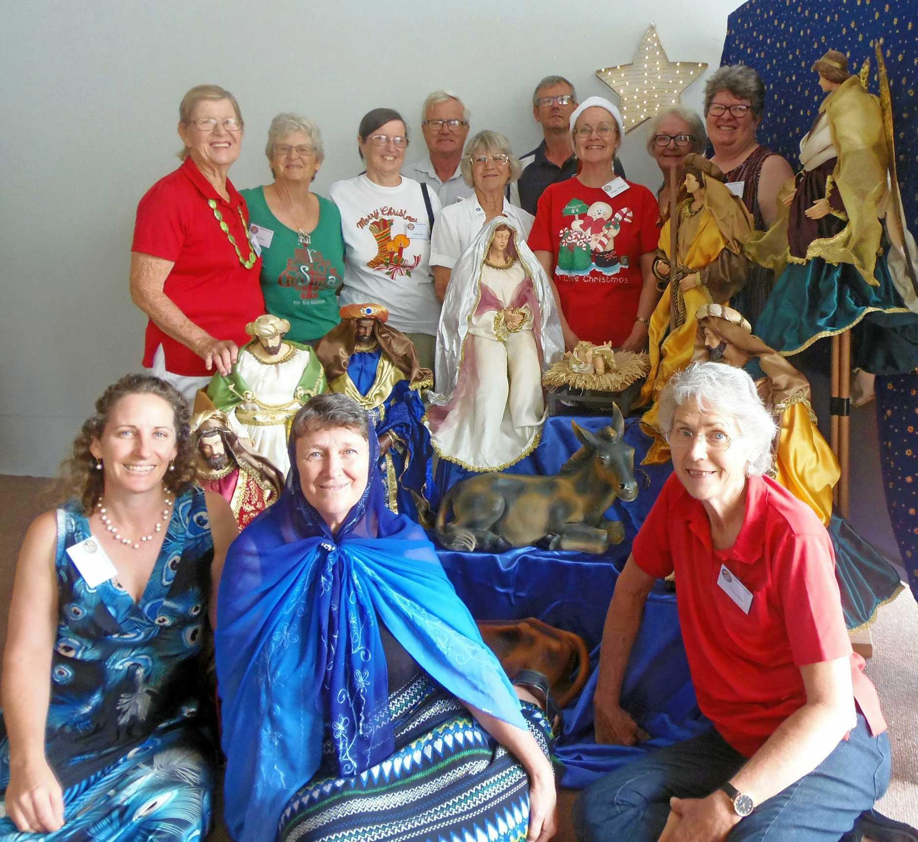 Volunteers from Warwick's Christian Churches gather around the Nativity Scene.