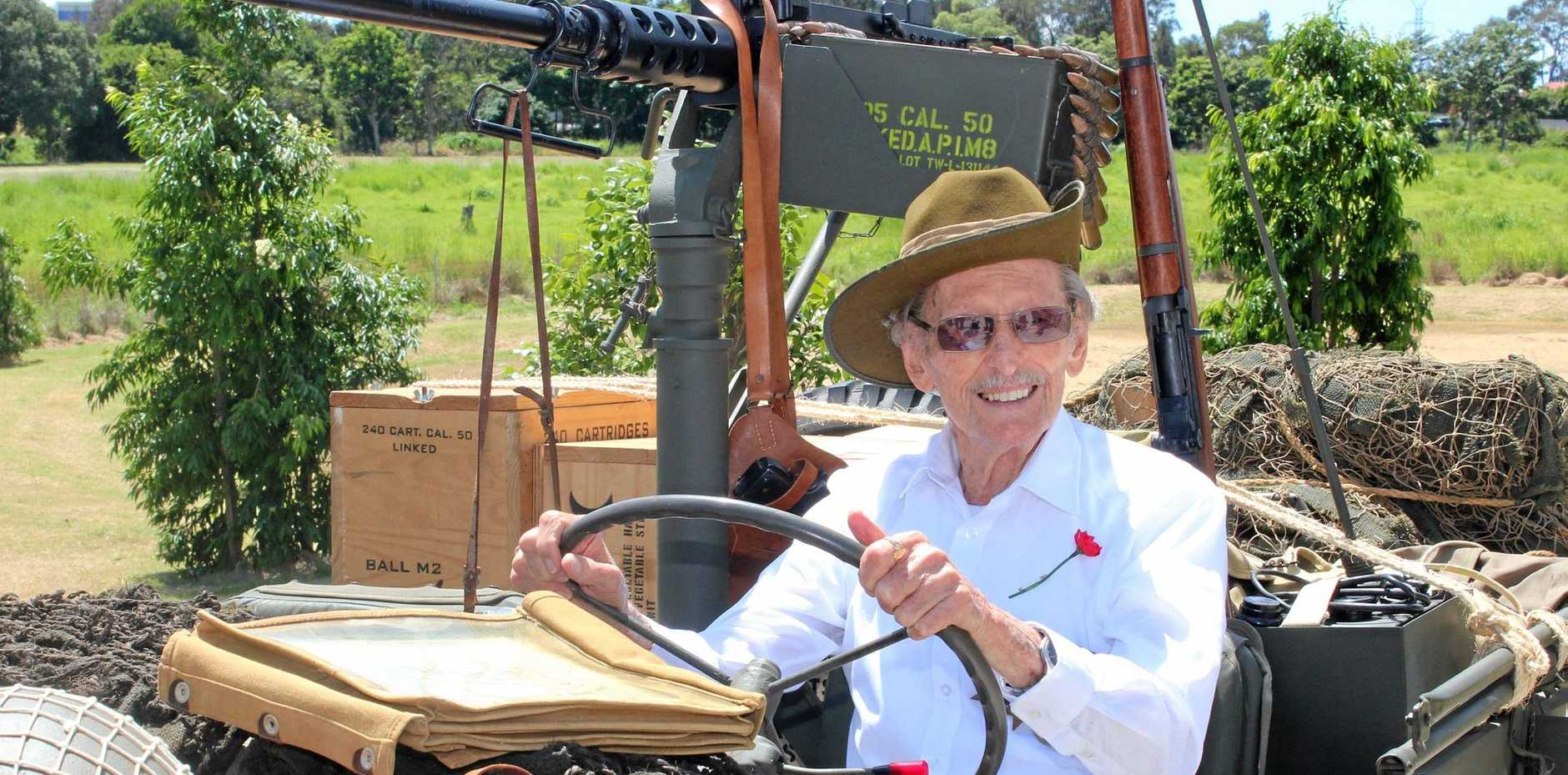 REMEMBRANCE DAY: Carinity Cedarbrook resident Gordon Jamieson, 97 in a WWII jeep, is one of Queensland's last surviving POW's and Thai-Burma railway workers. Gordon honoured his fallen army mates on November 11.