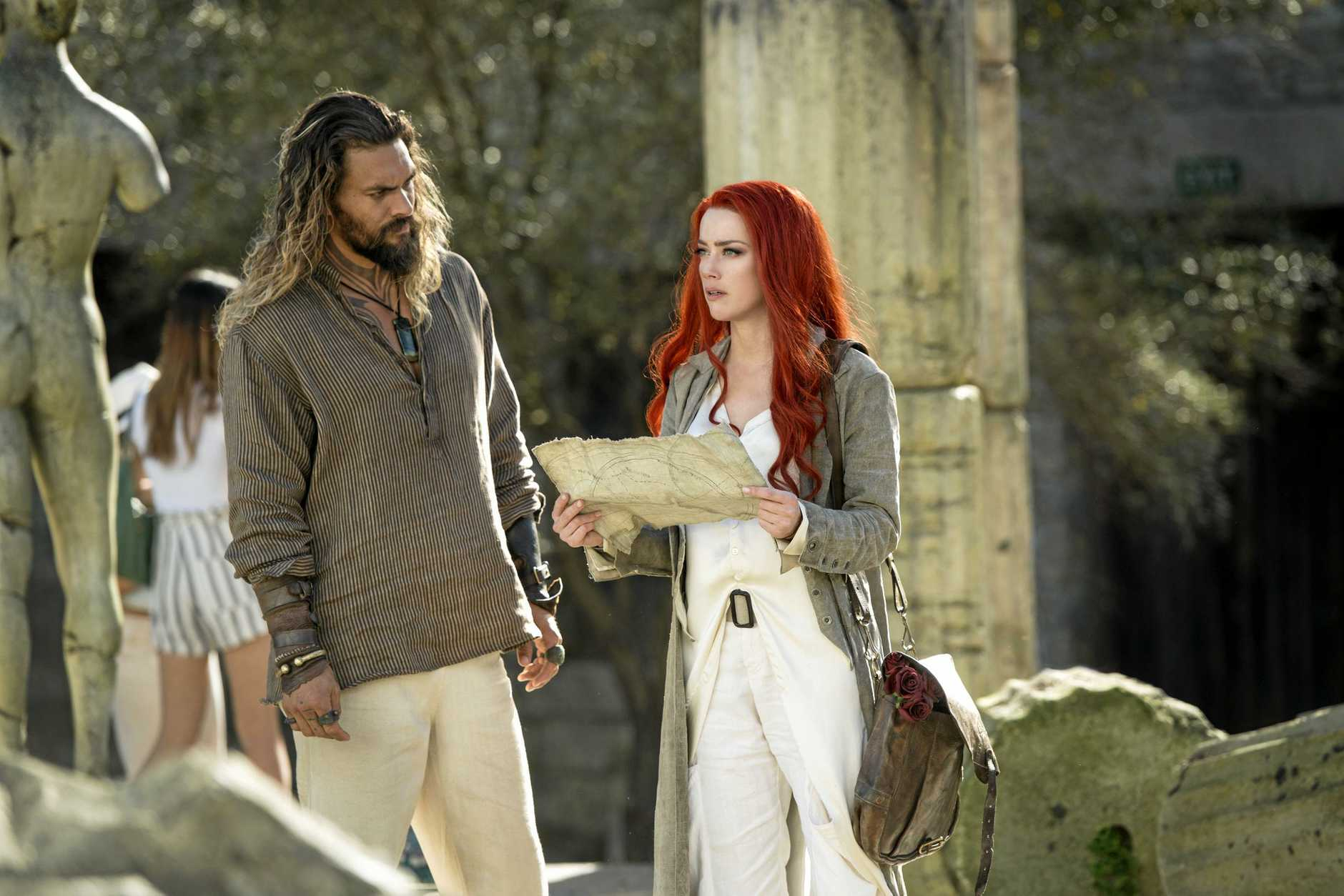 Jason Momoa and Amber Heard in a scene from the movie Aquaman. Supplied by Warner Bros.