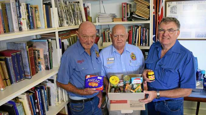 THINKING OF YOU: John Moffitt, Murray Travis and Raymond Heath packing boxes of goodies to send to troops in Afghanistan for Christmas.
