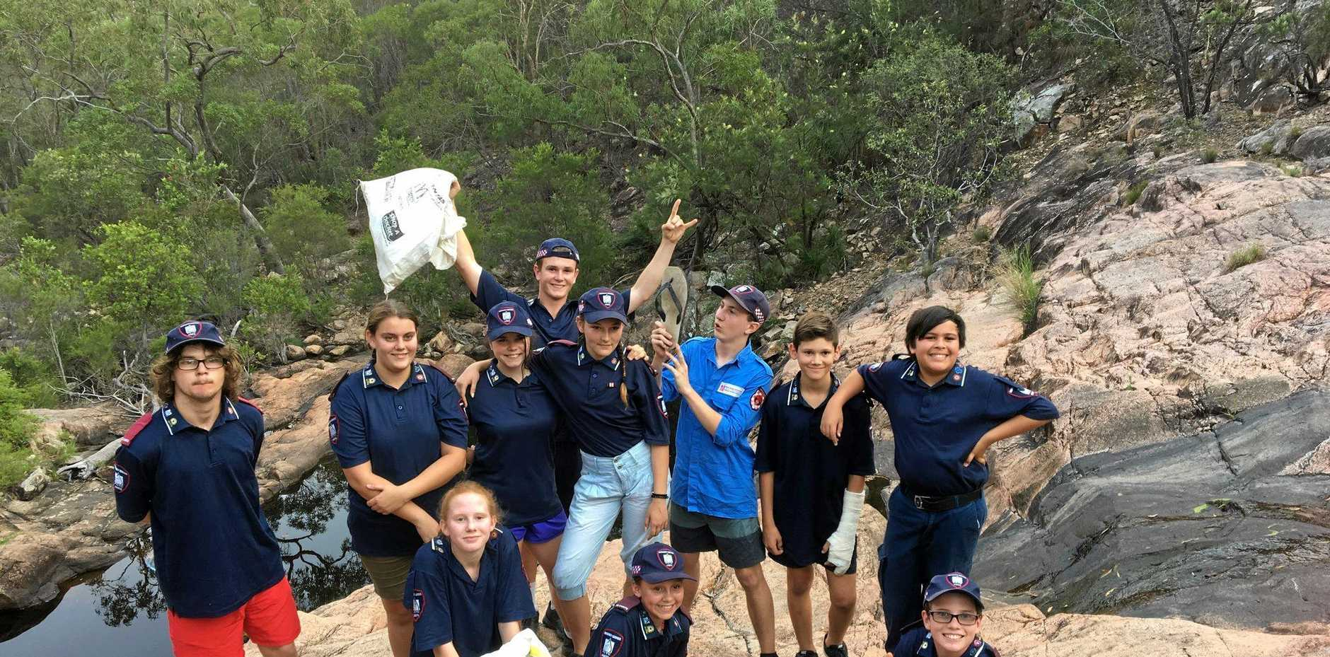 GIVING A HAND: Biggenden PCYC ES cadets spent their weekly training night cleaning up the rock pools at Utopia last week.