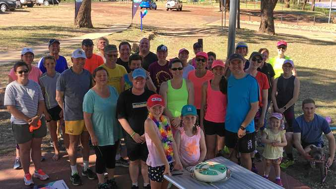 RUNNING AS ONE: St George parkrun members celebrate their first year as a club.