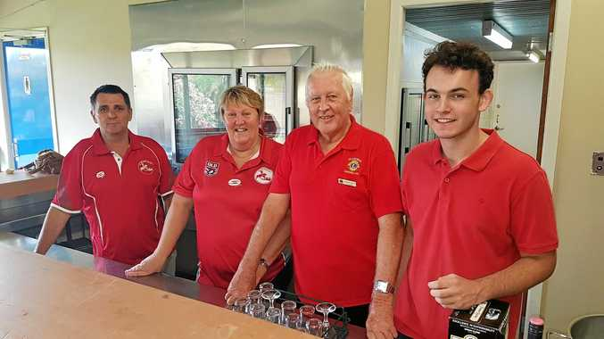PULLING TOGETHER: St George Rugby League president Kelvin Bella and treasurer Tanya Griinke, Lions member Graham Nosse and 2018 Lions Youth of the Year William Fisher help behind the bar.