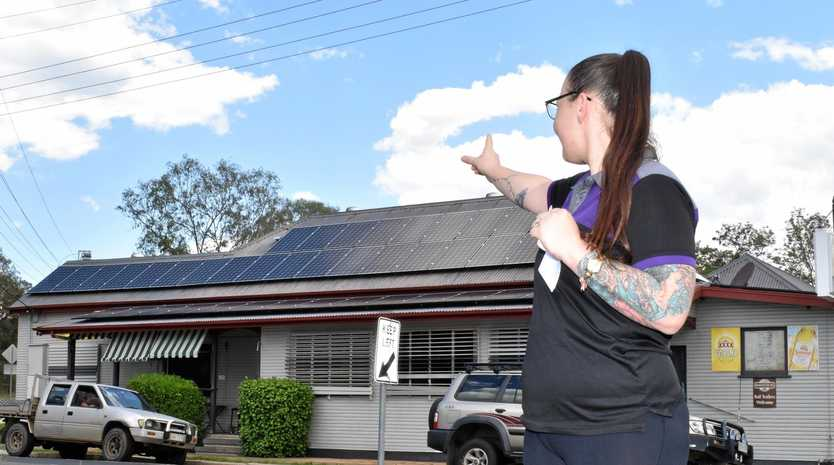 NEW INVESTMENT: Skye Stoessel shows off the new solar panels at the Bellevue Hotel in Coominya.