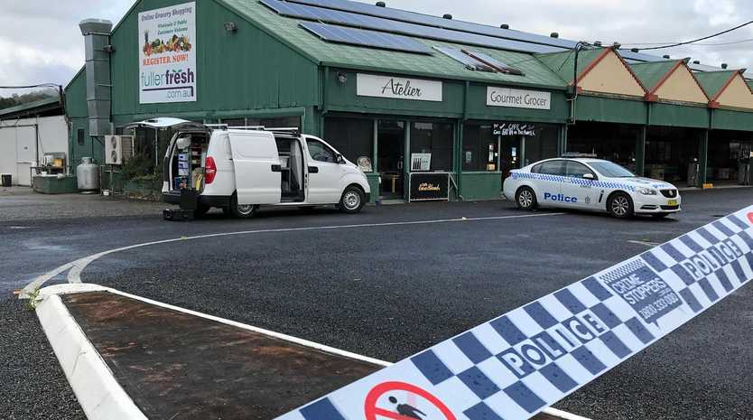 CRIME SCENE: Police inspect one of the crime scenes linked to the alleged robbery and kidnapping at Bellingen in May.