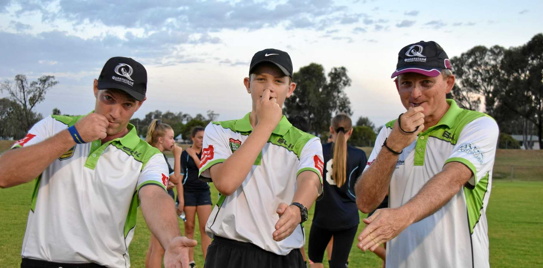 TRY TIME: Referees, Dan Wojtasek, Toby Schmidt and Jason Wyeth take charge at the touch football grand finals on Monday night.