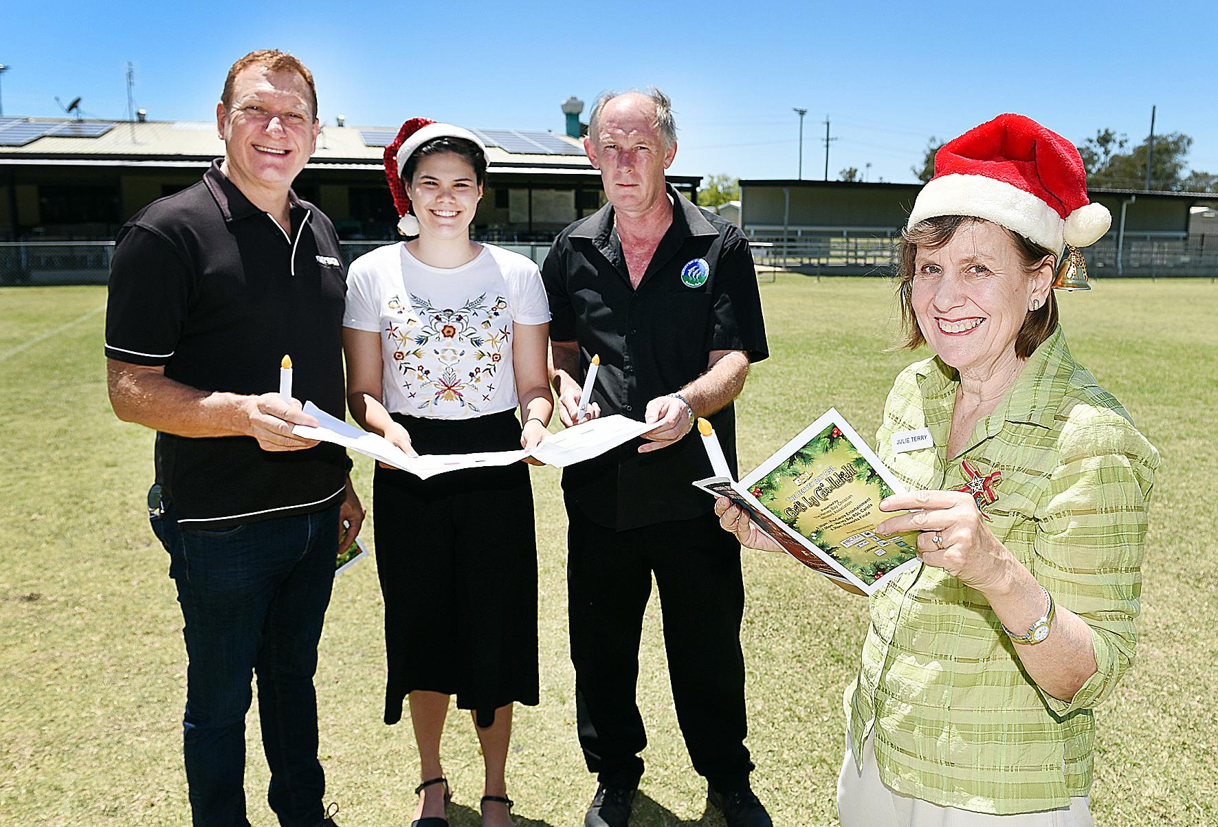 SING OUT LOUD: Pastor Ross Davie, Kerri Hetherington, Hervey Bay Sports Club manager Chris Bleakley and organiser Pastor Julie Terry, are working hard to ensure this year's RSL Carols by Candlelight is a great success in the new location.