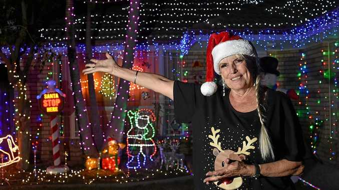 Lyn welcomes visitors to her Phoenix Circuit, Sippy Downs home to view the Christmas lights.