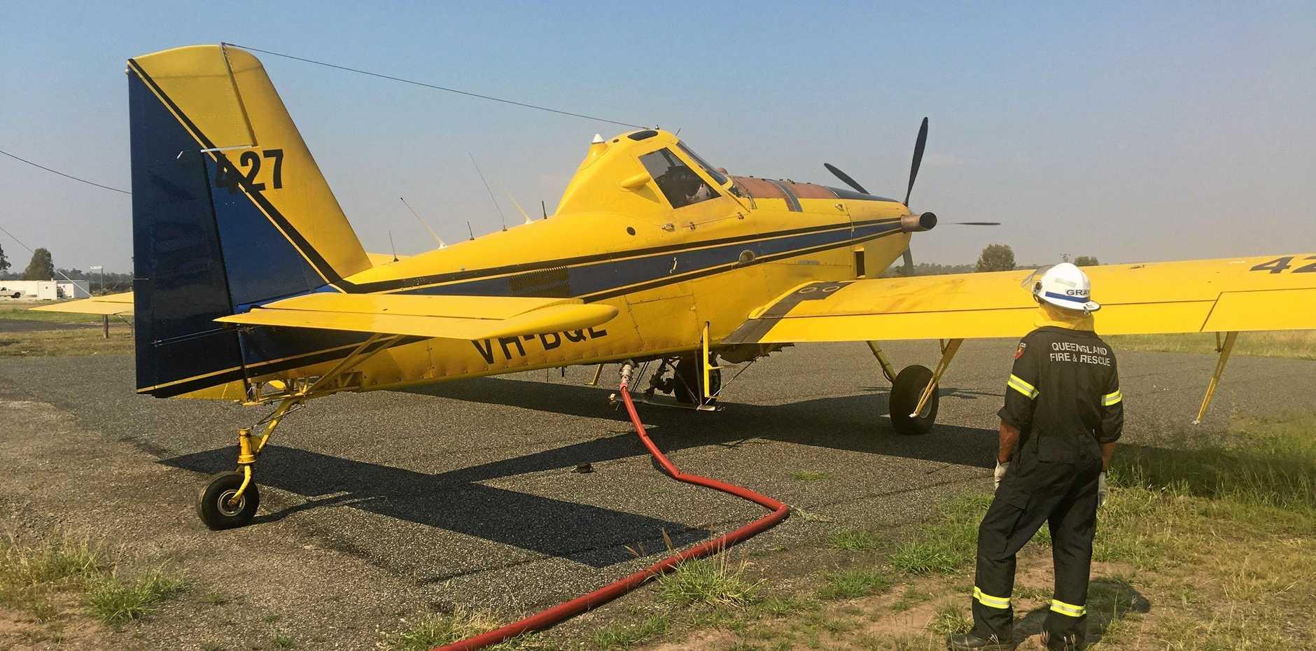Water bombers preparing for take-off at Gayndah airport for the Kalpowar fires in December, 2018.
