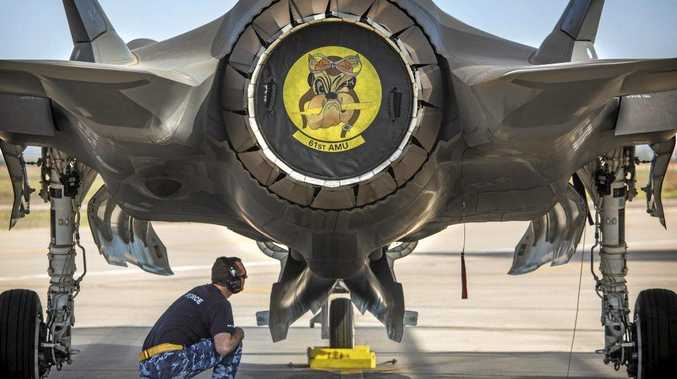 UNDERSIDE: Royal Australian Air Force aircraft maintainer Corporal Cory Cochrane inspects the bomb bay of an Australian F-35A on the flight line in Arizona.