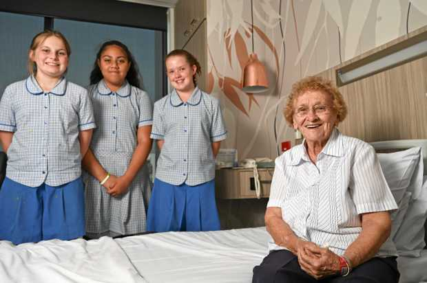 Good Shepherd Catholic Primary School students, Ella D'Alterio, Avva Moimoi-paugaand  Mikayla Crow sang Christmas carols to Mater Private Hospital patient Audrey Chapman who was delighted by their presence.