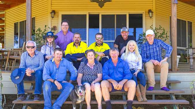 FRONT: Adam, Helen and Michael McKellar. BACK: volunteers from the RACQ Foundation and the Weekend Sunrise crew at Booka Station, Morven.