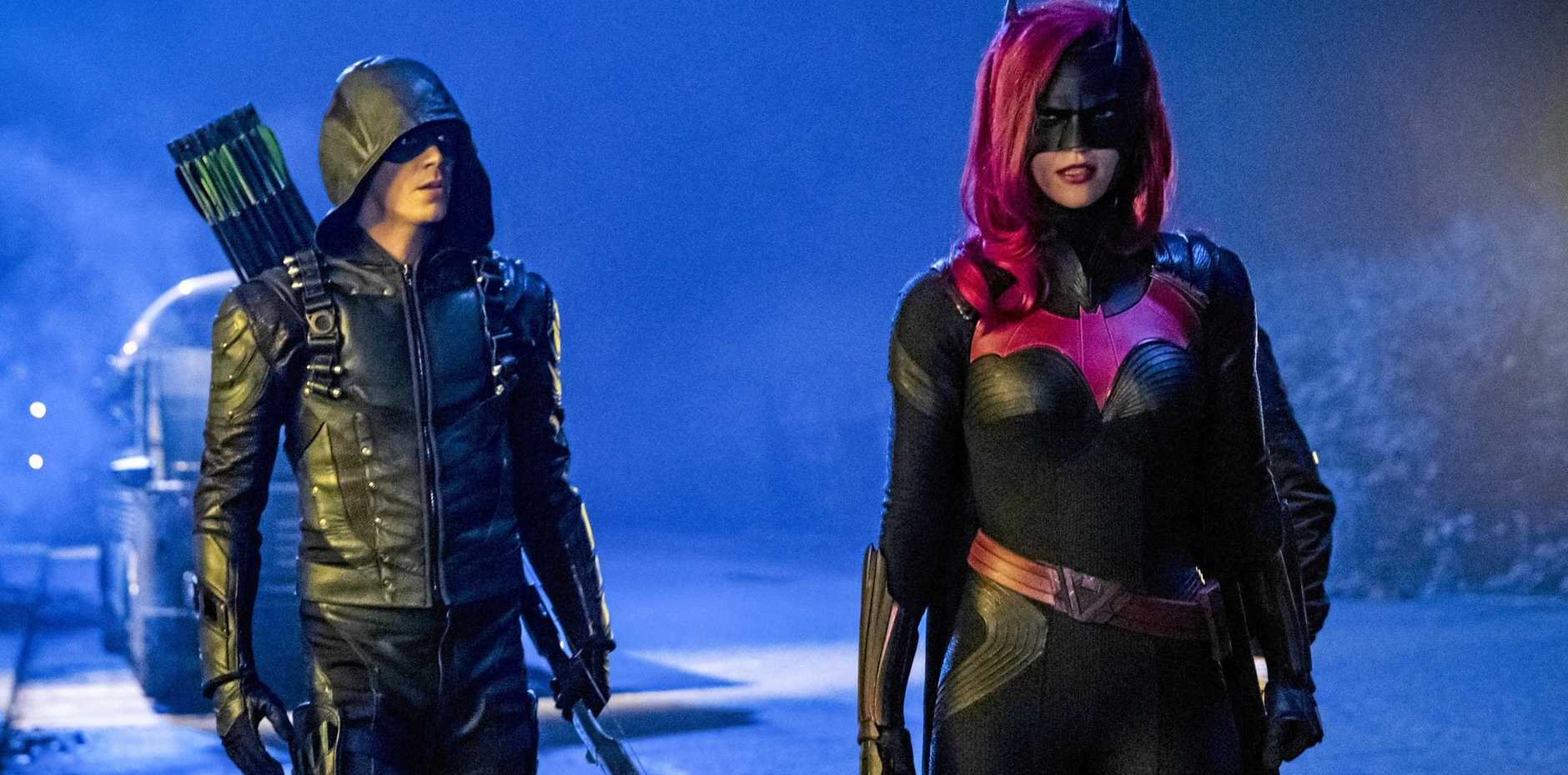 Grant Gustin as Oliver Queen/Green Arrow and Ruby Rose as Kate Kane/Batwoman in a scene from Arrow's DC Crossover episode Elseworlds Part 2.