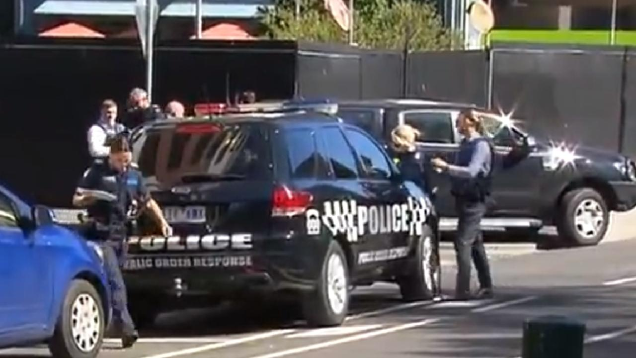Police respond to a sighting of three men — one armed with a gun — with a gun entering housing commission flats in Carlton. Picture: 7 News