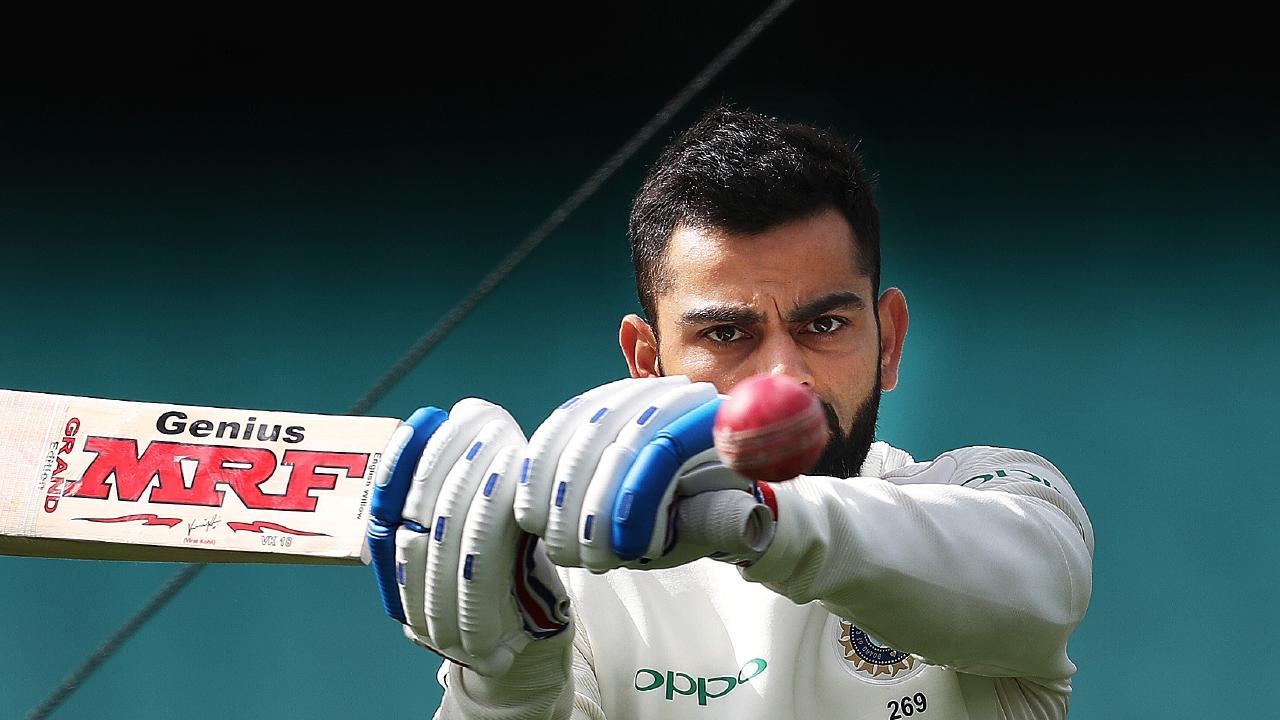 Virat Kohli warms up during India v CAXI tour match at the SCG.