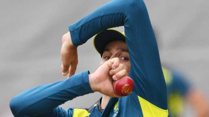 Nathan Lyon spins up a storm in the Adelaide Oval nets on Tuesday. Picture: AAP