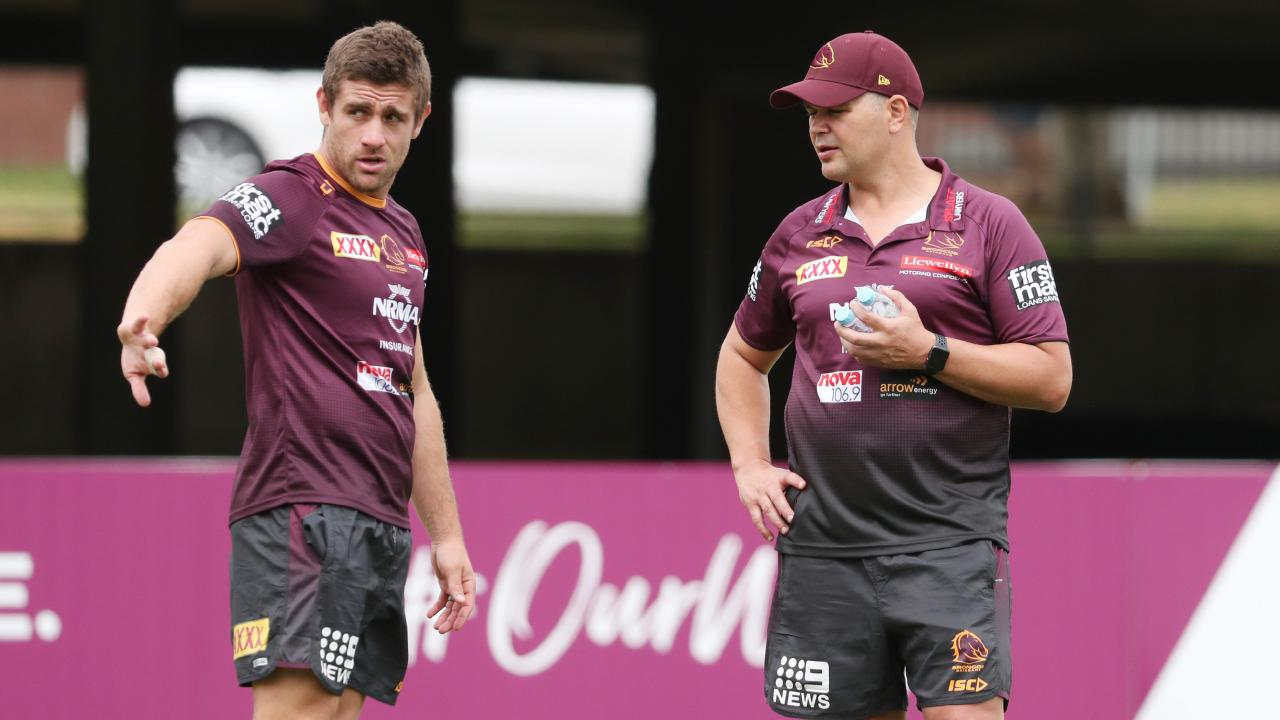 Andrew McCullough talks with Anthony Seibold during a Broncos training session. Picture: Peter Wallis