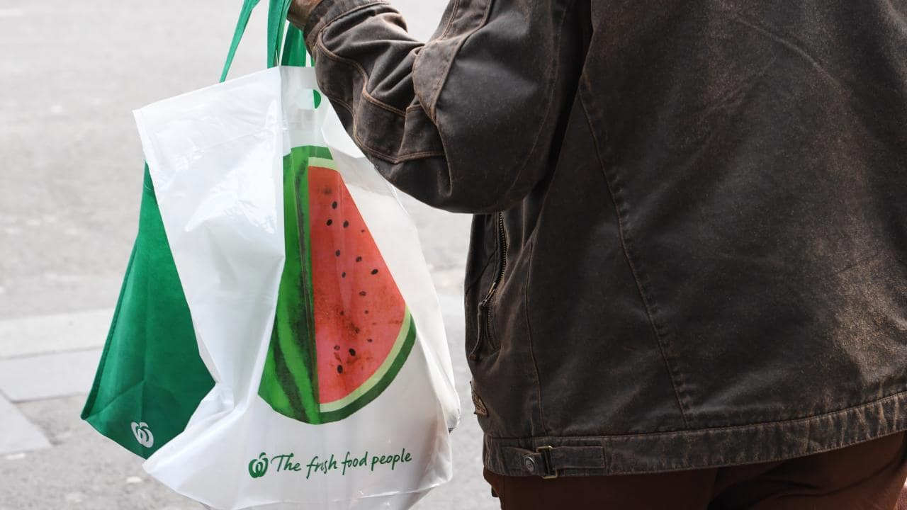 Woolworths stores in NSW, Queensland, Victoria and Western Australia stopped providing free single-use plastic bags on June 20. Picture: AAP Image/Peter Rae