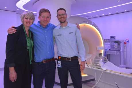 Celebrating the installation of the new coil are (from left) Tess Bourke, Lachlan Miles and Aiden Cook.